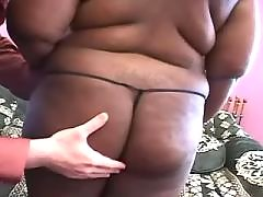 Appetizing ebony fatty takes a ride black chubby porn